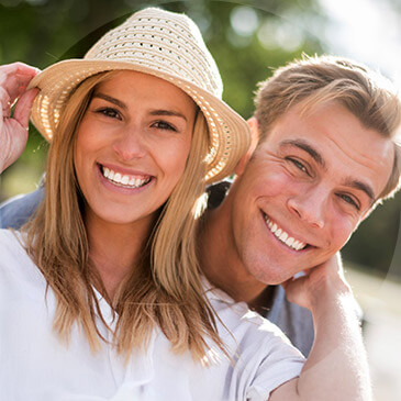 Young smiling couple embracing outdoors