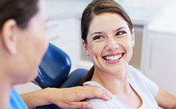 Dentist conversing with dental patient