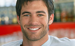 Columbia Preventive Dentistry handsome male patient smiling