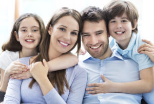 smiling parents and two kids