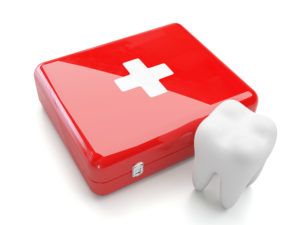 red first aid kit beside tooth
