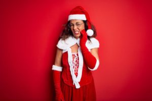 woman in Santa suit with toothache