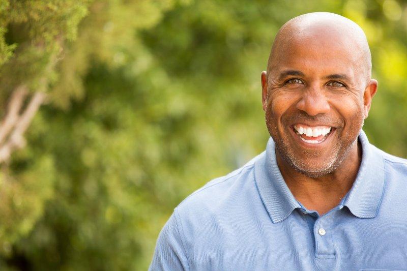 older man smiling bald head