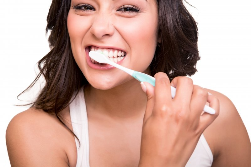 attractive woman smiling brushing teeth