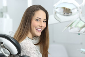 Woman at dentist in Columbia smiling