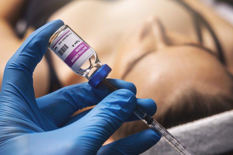 Dentist filling syringe with BOTOX
